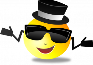 a smiley face emjoi with sunglasses on and a top hat on with hands out shrugging